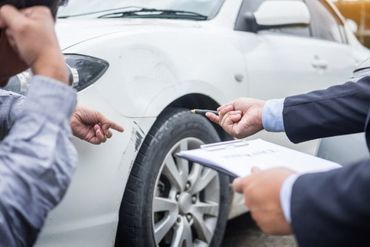 man signing the insurance papers